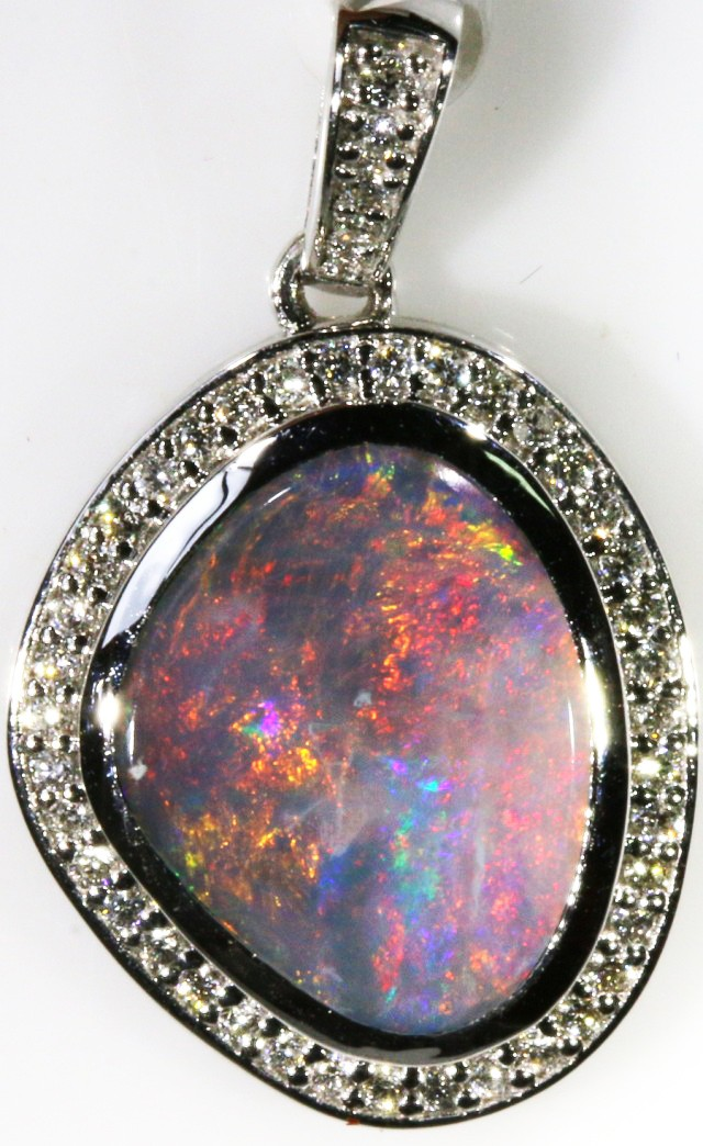 Beautiful black opal from lightning ridge displaying hues red flash and mul