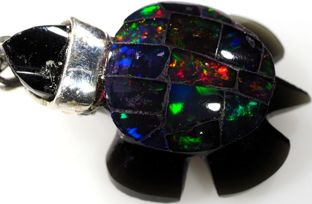 17.60 CTS FIREY  MEXICAN OPAL TURTLE CARVING [VS7511]