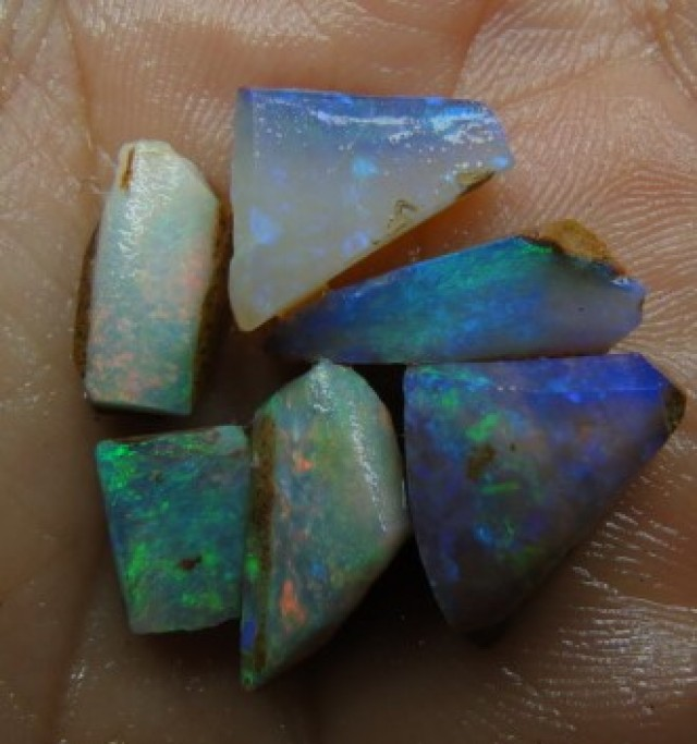 22.35CT SMALL BRIGHT WOOD FOSSIL BOULDER OPAL  SS01277