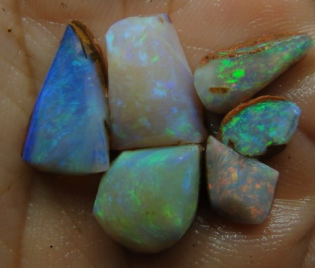 20.40CT SMALL BRIGHT WOOD FOSSIL BOULDER OPAL  SS01281