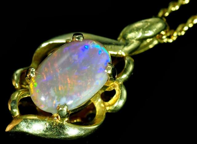 Black Opal set in 18k Gold Pendant  SB640