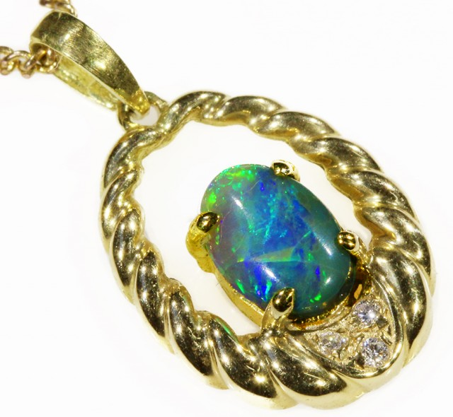 Black Opal set in 18k Gold Pendant  CF 1043