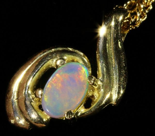 Fire Opal set in 18k  Gold Pendant  CF 1054