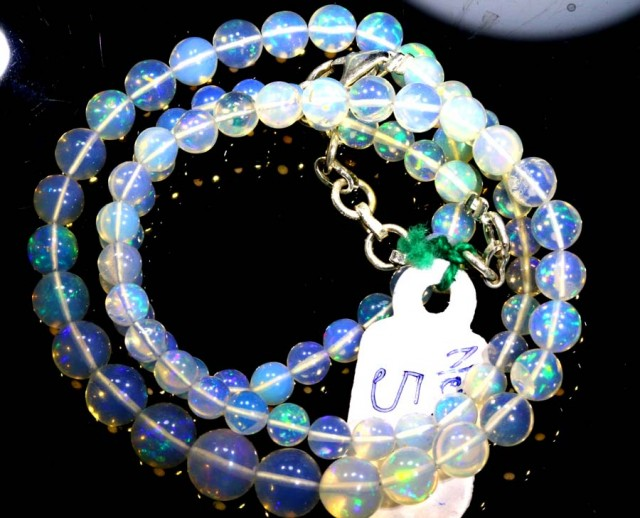 57.35CTS ROUND OPAL BEAD STRAND FOB-1075