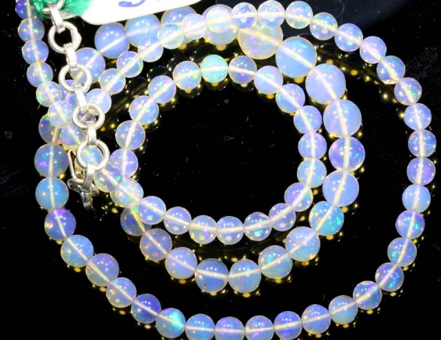 56.45CTS ROUND OPAL BEAD STRAND FOB-1076