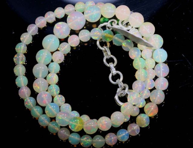 52.9CTS ROUND OPAL BEAD STRAND FOB-1082