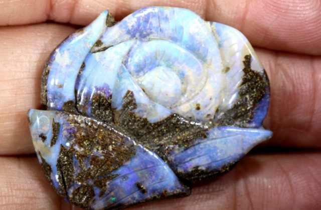 38.30 CTS BOULDER OPAL CARVING  LO-4258