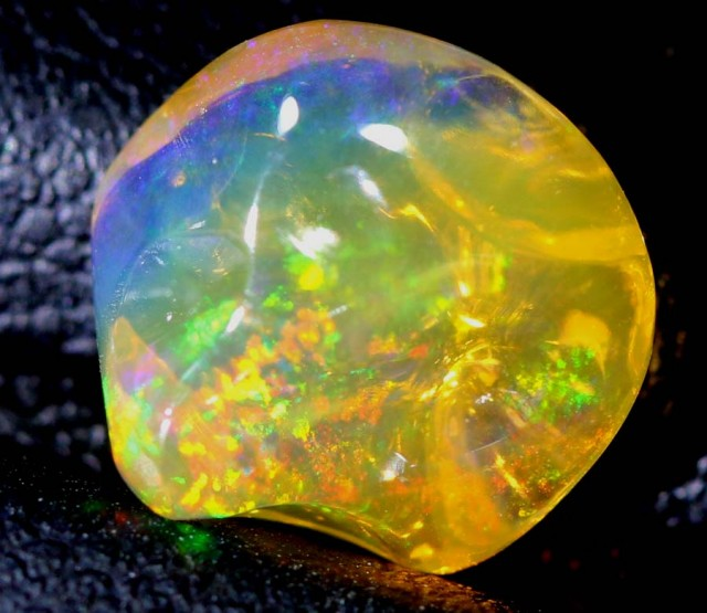 2.6 CTS MEXICAN FIRE OPAL CARVED STONE FOB-1175