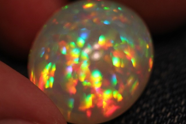 17.76CT COLLECTORS ETHIOPIAN WELO OPAL INSANE PRISM FIRE!!!!
