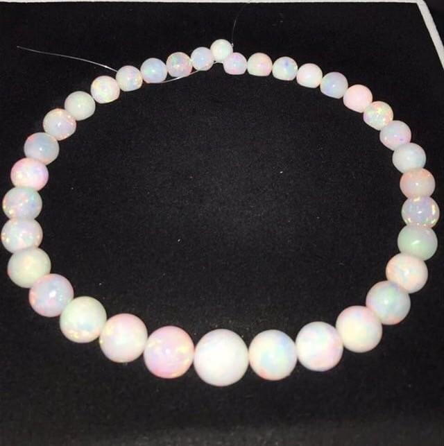 241.91ctw AAA Gem Quality 9-15mm Ball Shape Welo Ethiopia Opal Bead Strand