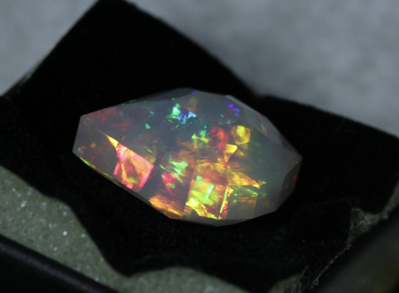 Very bright flame style pattern in this opal.  Love the displays of color as it's gets rotated.   Photos in different light to show the stone off accurately.