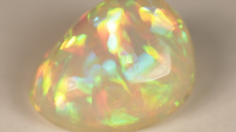 Strong colored in a straw pattern opal that is especially rare in this strength of color and density of color.