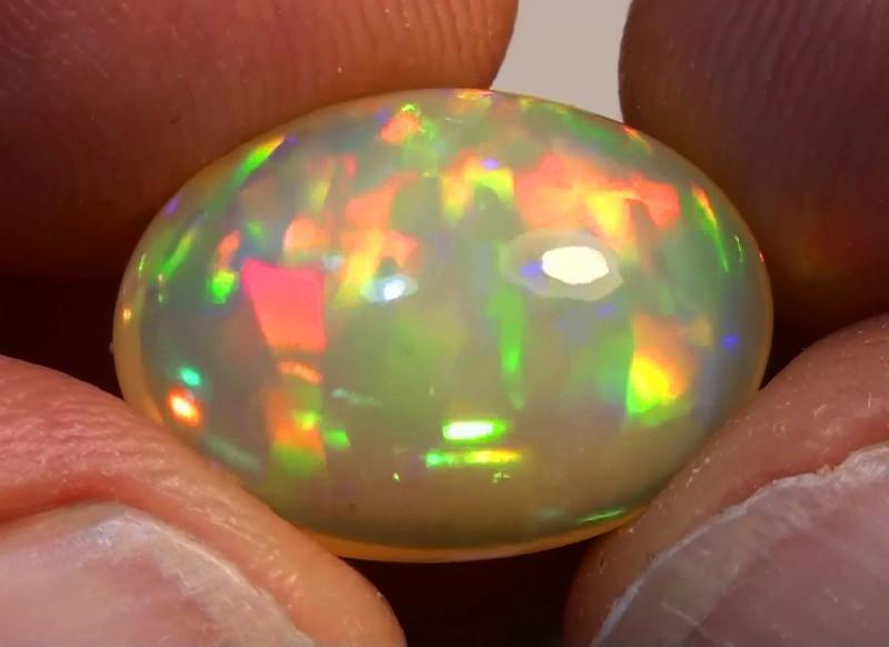 7.20 ct $1 NR Gem Quality Full Gem Rainbow Welo Cab M60
