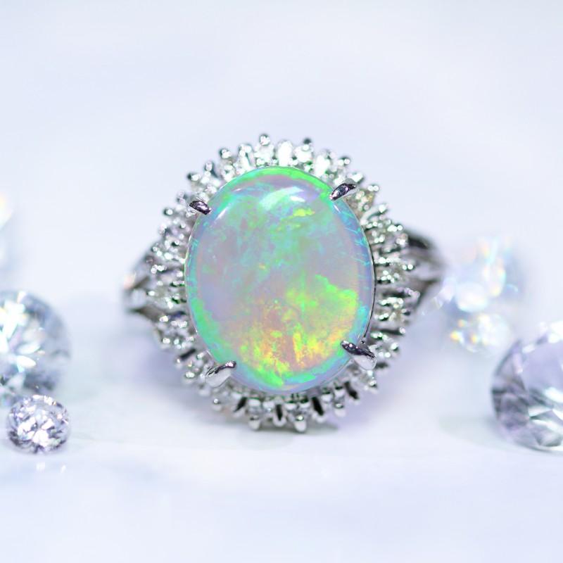Elegant Crystal opal set in platinum ring