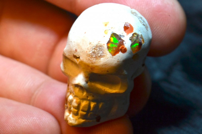 50.83CT RAINBOW SKULL  BRIGHT CARVED FIGURINE  MEXICAN MATRIX OPAL