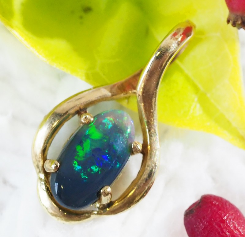 Solid Black Opal Set in 18K Yellow Gold Pendant SU502