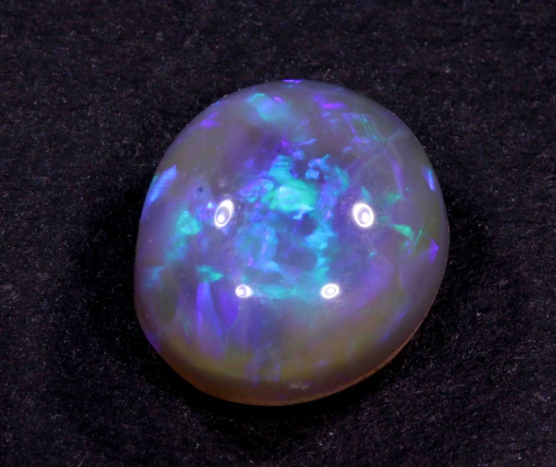 3.95 CTS  BLACK OPAL FROM LR -