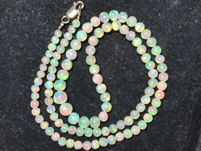 Sale-18kt Clasp AAA Welo Ethiopia Opal Ball Bead 19inch Strand. 5-8mm. 54ct