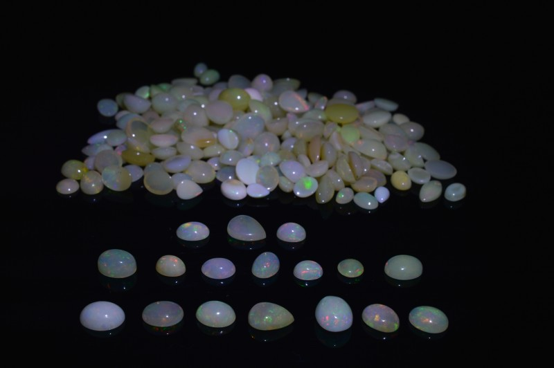 Opal 142.84 cts 184 stones Wholesale Lot