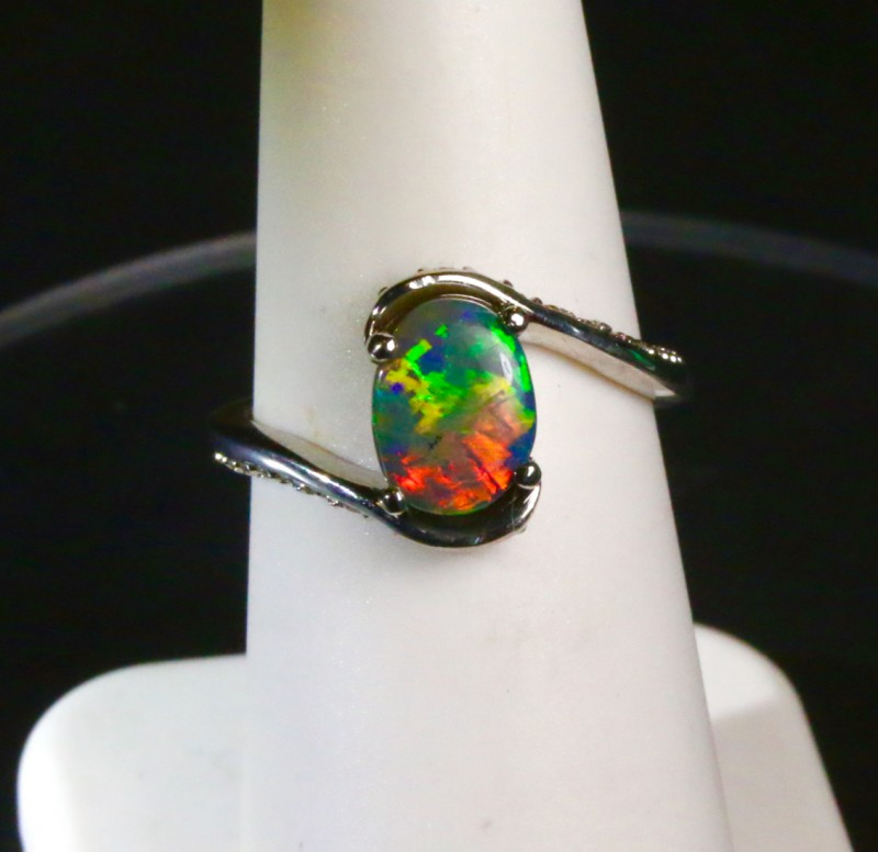 """Black opal engagement ring with diamond band.  I call this my """"French Twist design"""". Created by opal ring designer Amy Klitsner."""