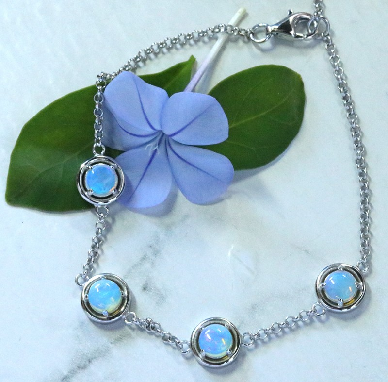 Solid Crystal opals in tennis style silver bracelet SU 1480
