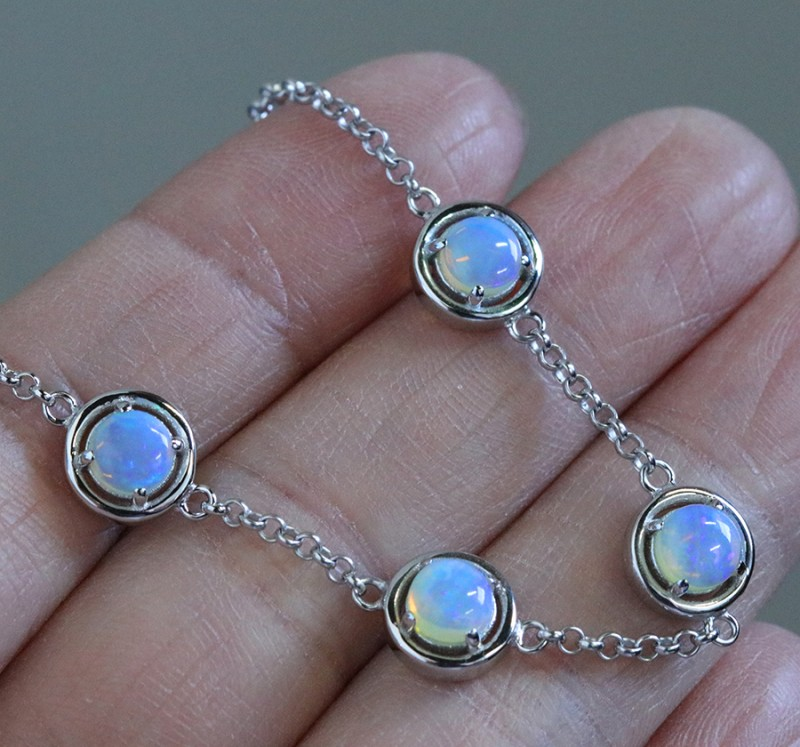 Solid Crystal opals in tennis style silver bracelet SU 1481