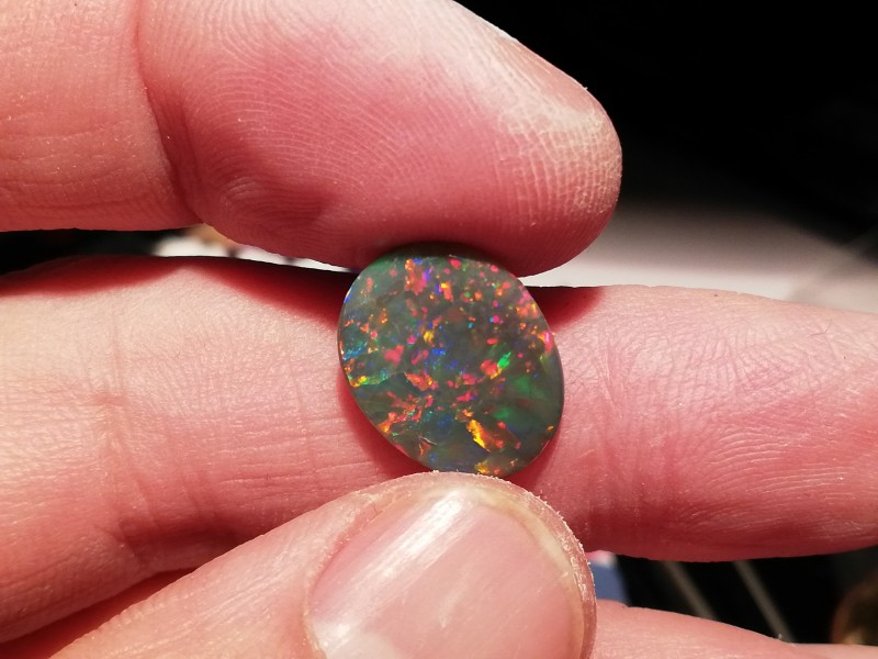 3.75 cts Natural solid black opal with multiple sparkling gem fire for coll