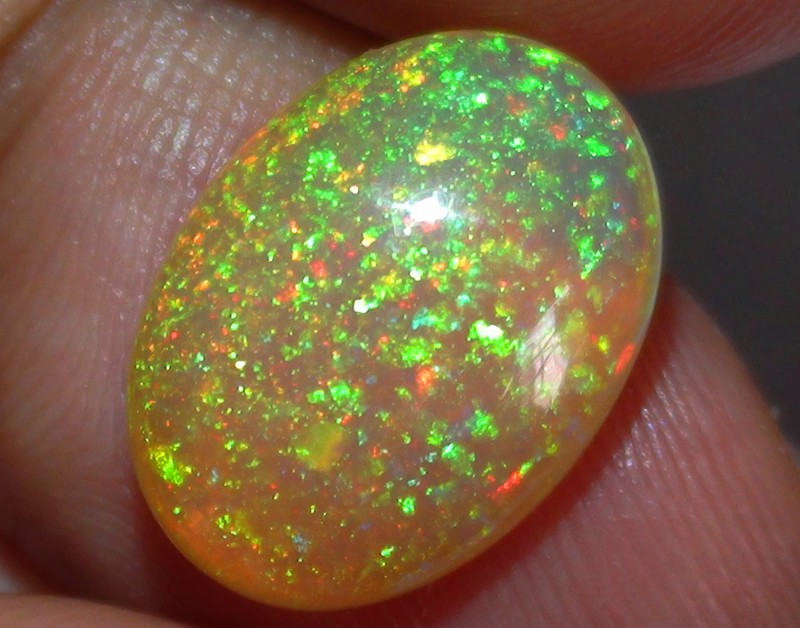 4.25 ct Gem Quality Full Gem Rainbow Confetti Welo Cab M188
