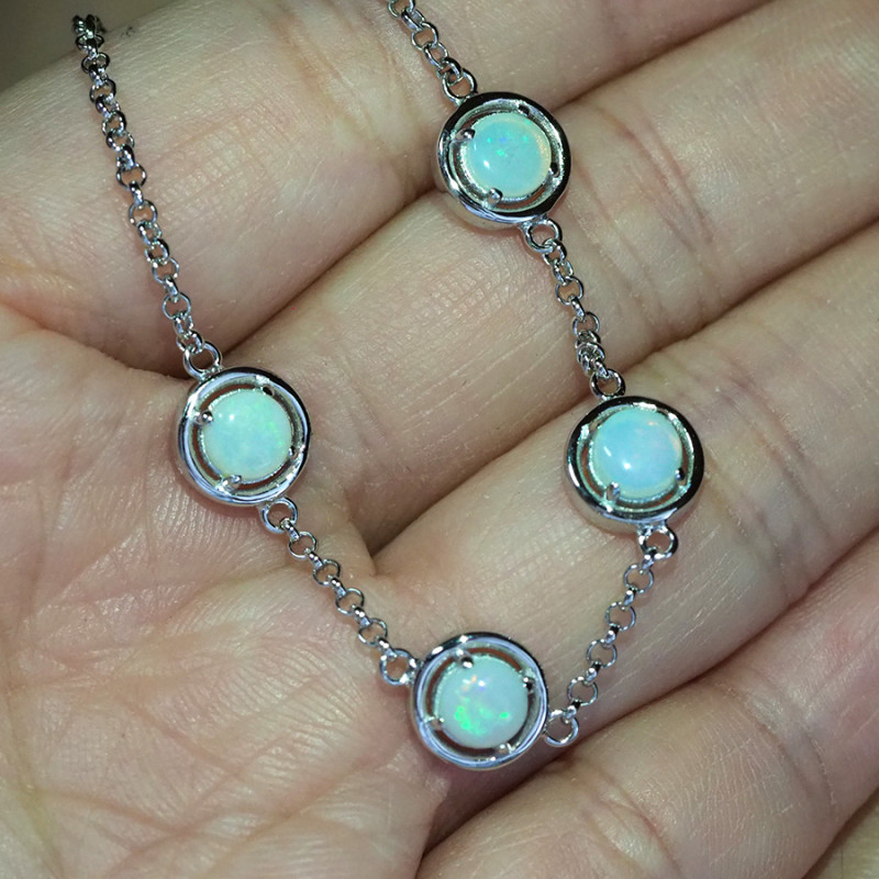 Solid Crystal opals in tennis style silver bracelet WS581