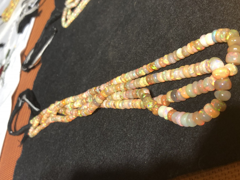 Two strands totaling 119 carats.