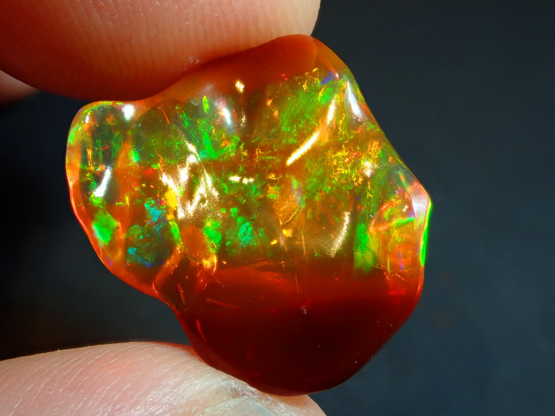 8.09CT  EXTREMELY BRIGHT CARVED  MEXICAN  FIRE OPAL