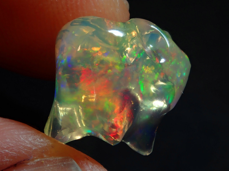 7.64CT  EXTREMELY BRIGHT CARVED  MEXICAN  FIRE WATER OPAL