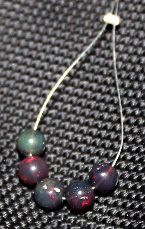 2.65 Crts Natural Ethiopian Welo Smoked Opal Balls Demi Strand 32