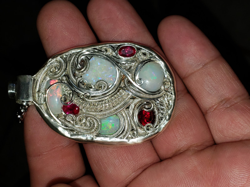 Opal pendant with ruby accents