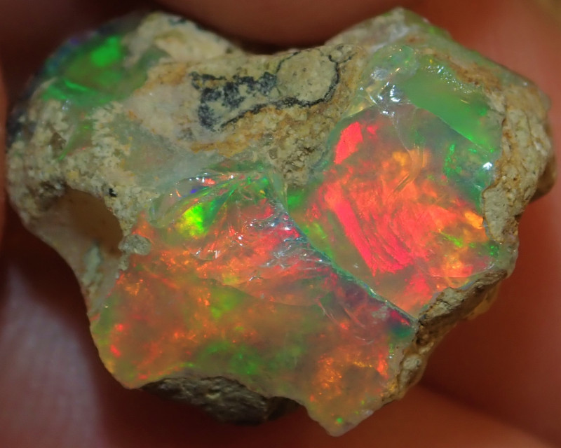 13.60ct. Blazing Welo Rough PinFire Opal COLLECTORS STONE ( Sand Included)