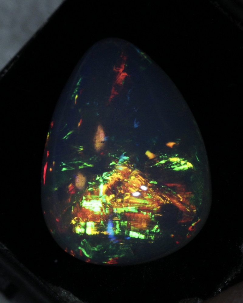 Insane color patterns inside this beautifully polished symmetrical cut stone.  Very clear opal with very bright sheet style patterns.