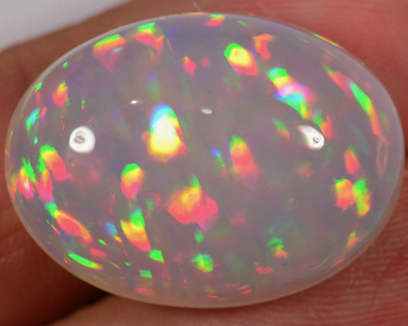 24.2 CT - AMAZING HUGE RAINBOW PRISM WELO OPAL CABACHON