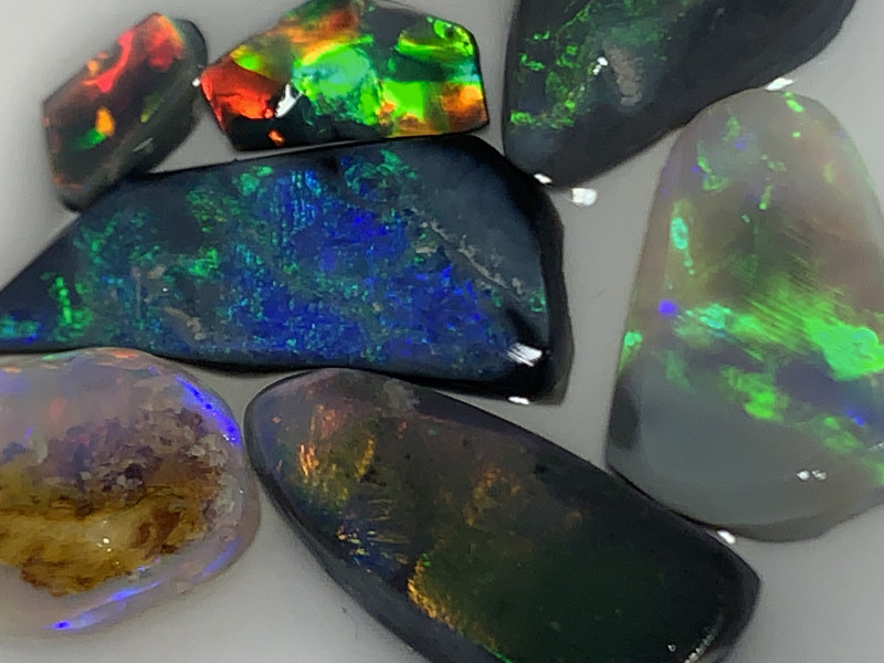 BEAUTIFUL RUBS; 15 CTs of Lightning Ridge Opal Rubs  #2127