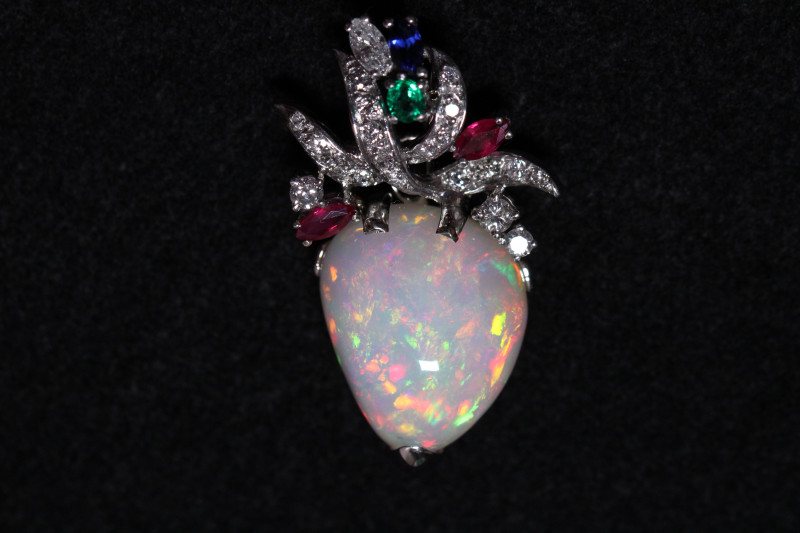 Excellent Ethiopian opal pendant with diamonds, rubies, sapphire and emeral