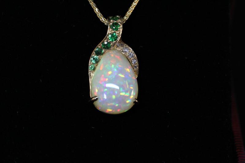 opal welo pendant with emeralds