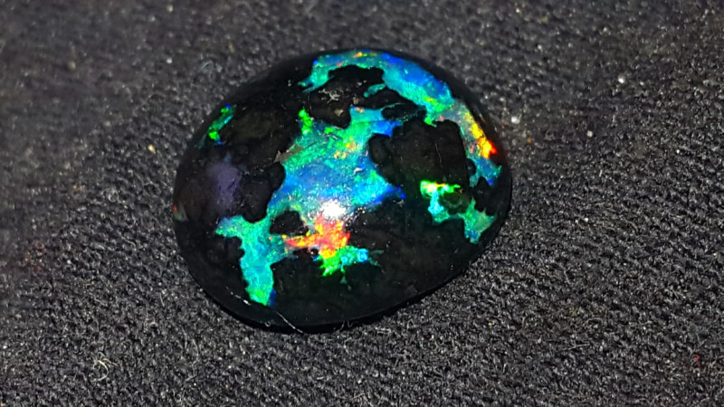 3.00 CRT STUNING BLUE PLAY COLOR ROLLING FLASH INDONESIAN OPAL WOOD FOSSIL