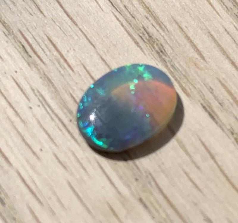 Beautiful lightning ridge semi black/crystal opal cab