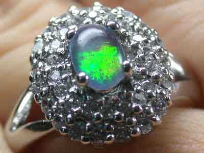 BRIGHT  OPAL TRIPLET RING SIZE 8.5 OPAL RD 150