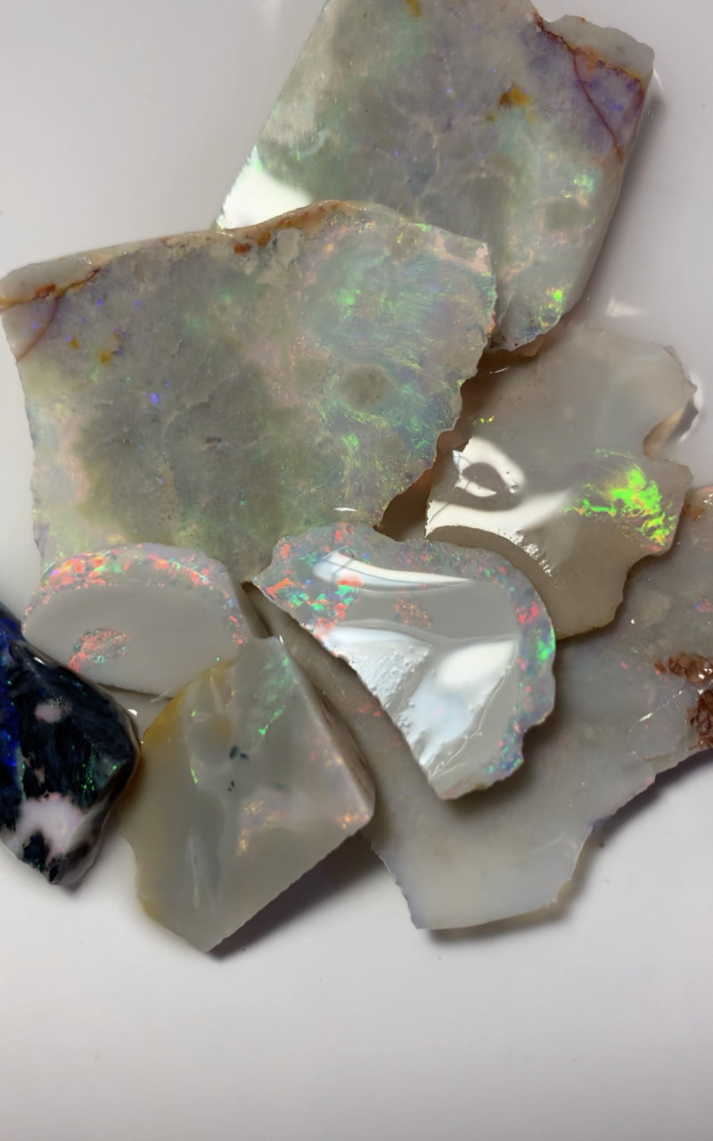 SEE VIDEO- STRANGE SLICES OF ROUGH OPALS #614