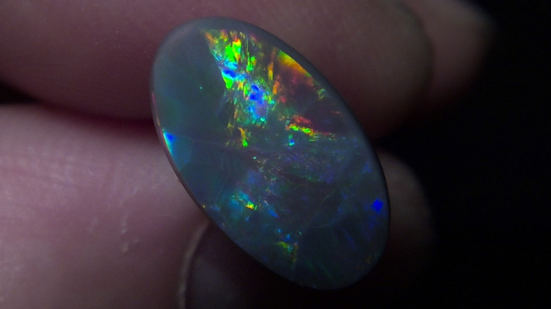 2.75ct lightning ridge black opal with multiple Gem colors