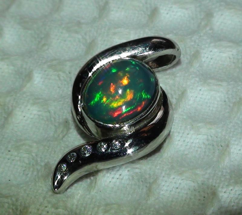 Silver Ethiopian Opal Pendant With Cubic Zirconia