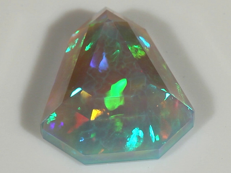 7.39CT GRAND MASTER FACETED ETHIOPIAN WELO OPAL WITH NEON FIRE