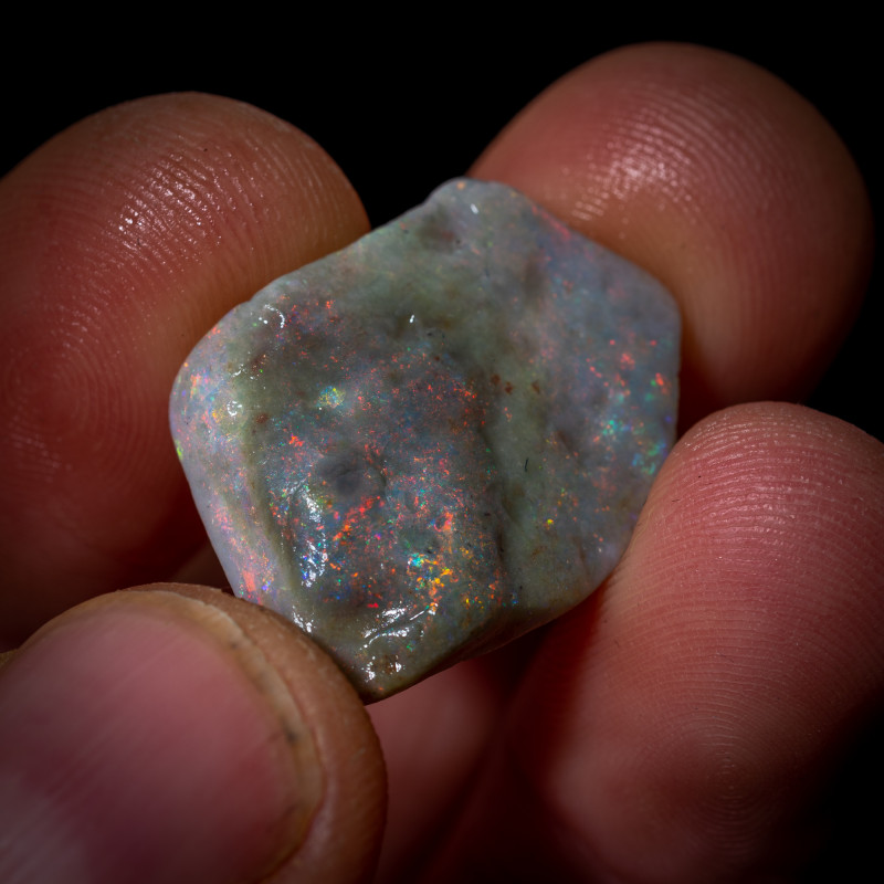 13.20 carats Lightning Ridge rough Opal - Red multicoloured part semi black